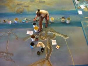 peintre décoratur en train de peindre pour le festival de loire